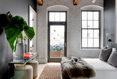 Bedroom with whitewash brick wall.