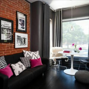 The exposed red brick wall brings out the warmth in the room
