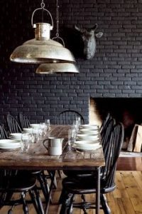 Exposed dark brick wall and metal accents